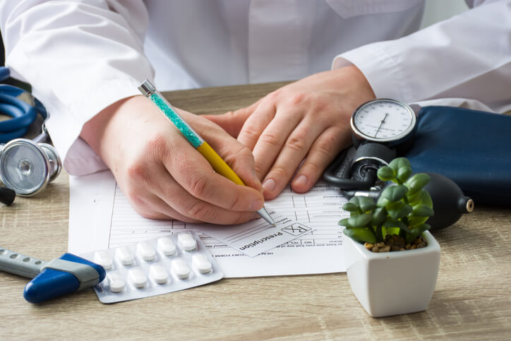 Pharmacist looking at smart data to increase patient adherence